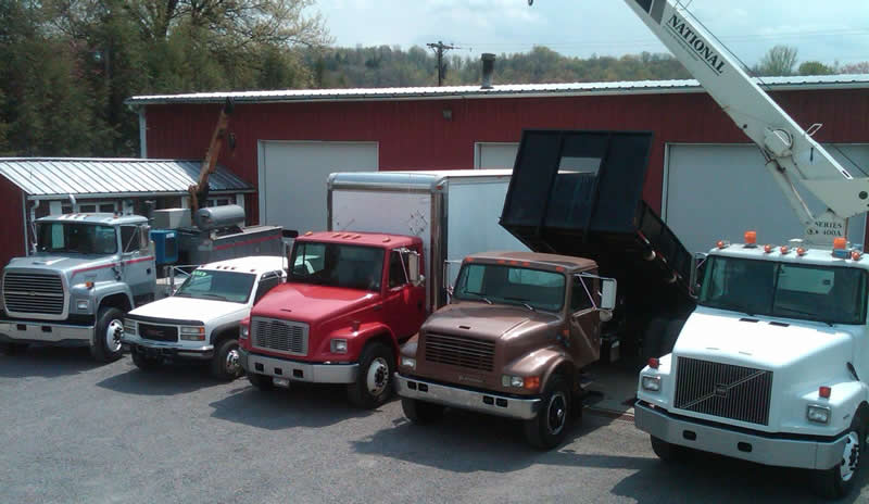 Picture of trucks in front of the shop